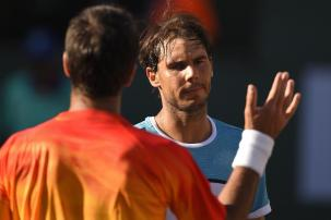 Rafael Nadal, of Spain, reacts after defeating Fernando Verdasco, of Spain, left, during the BNP Paribas Open tennis tournament, Tuesday, March 15, 2016, in Indian Wells, Calif. (AP Photo/Mark J. Terrill)