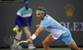 Rafael Nadal, of Spain, returns a shot to Gilles Muller, of Luxembourg at the BNP Paribas Open tennis tournament, Sunday, March 13, 2016, in Indian Wells, Calif. (AP Photo/Mark J. Terrill)