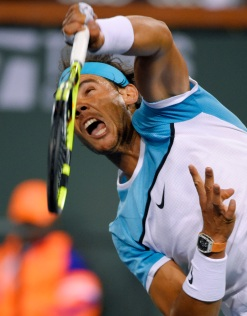 Rafael Nadal, of Spain, serves to Gilles Muller, of Luxembourg at the BNP Paribas Open tennis tournament, Sunday, March 13, 2016, in Indian Wells, Calif. (AP Photo/Mark J. Terrill)