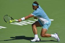 Rafael Nadal, of Spain, returns to Kei Nishikori, of Japan, during their quarterfinal match at the BNP Paribas Open tennis tournament, Friday, March 18, 2016, in Indian Wells, Calif. (AP Photo/Mark J. Terrill)