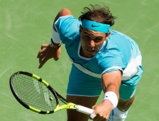 Rafael Nadal of Spain returns a shot to Kei Nishikori of Japan during their men's quarterfinal match, on March 18, 2016, at the BNP Paribas Open at the Indian Wells Tennis Garden in Indian Wells, California. AFP/Robyn Beck