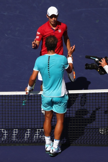 INDIAN WELLS, CA - MARCH 18: Rafael Nadal of Spain is congratulated by Kei Nishikori of Japan after his straight sets win during day twelve of the BNP Paribas Open at Indian Wells Tennis Garden on March 18, 2016 in Indian Wells, California. (Photo by Julian Finney/Getty Images)