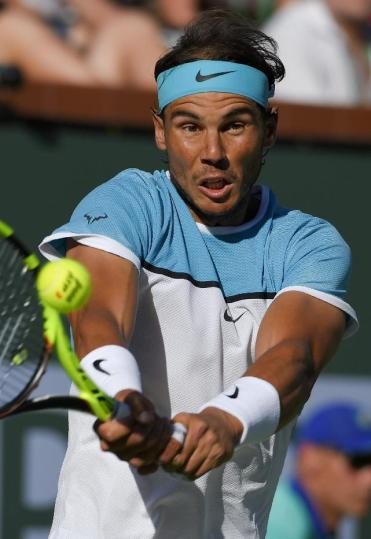 Rafael Nadal, of Spain, returns to Alexander Zverev, of Germany, during the BNP Paribas Open tennis tournament, Wednesday, March 16, 2016, in Indian Wells, Calif. (AP Photo/Mark J. Terrill)