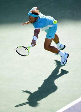 INDIAN WELLS, CA - MARCH 15: Rafael Nadal of Spain stretches for a backhand during his straight set victory over Fernando Verdasco of Spain at Indian Wells Tennis Garden on March 15, 2016 in Indian Wells, California. (Photo by Harry How/Getty Images)