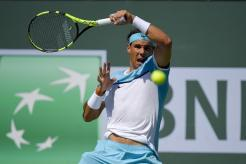 Rafael Nadal, of Spain, returns to Novak Djokovic, of Serbia, during their semifinal match at the BNP Paribas Open tennis tournament, Saturday, March 19, 2016, in Indian Wells, Calif. (AP Photo/Mark J. Terrill)
