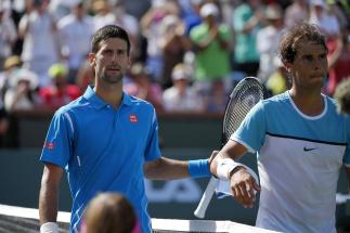 Novak Djokovic, left,of Serbia, walks off the court with Rafael Nadal, of Spain, after winning a semifinal at the BNP Paribas Open tennis tournament, Saturday, March 19, 2016, in Indian Wells, Calif. Djokovic won 7-6 (5), 6-2. (AP Photo/Mark J. Terrill)
