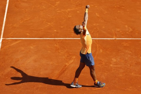 Spain's Rafael Nadal celebrates after winning a match against Britain's Andy Murray during the Monte-Carlo ATP Masters Series Tournament semi final match, on April 16, 2016 in Monaco. AFP PHOTO / VALERY HACHE / AFP / VALERY HACHE (April 16, 2016 - Source: AFP)
