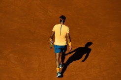 BARCELONA, SPAIN - APRIL 23: Rafael Nadal of Spain walks on the clay duirng his match against Philipp Kohlschreiber of Germany during day six of the Barcelona Open Banc Sabadell at the Real Club de Tenis Barcelona on April 23, 2016 in Barcelona, Spain. Nadal won 6-3, 6-3. (Photo by David Ramos/Getty Images)