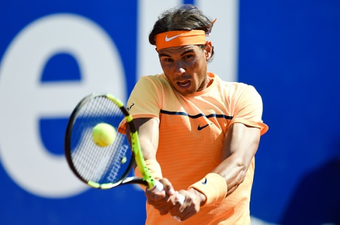 BARCELONA, SPAIN - APRIL 23: Rafael Nadal of Spain plays a backhand against Philipp Kohlschreiber of Germany during day six of the Barcelona Open Banc Sabadell at the Real Club de Tenis Barcelona on April 23, 2016 in Barcelona, Spain. Nadal won 6-3, 6-3. (Photo by David Ramos/Getty Images)