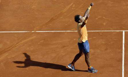 Spain's Rafael Nadal celebrates after defeating Austria's Dominic Thiem in their match of the Monte Carlo Tennis Masters tournament in Monaco, Thursday, April 14, 2016. (AP Photo/Lionel Cironneau)