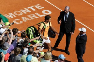 Rafael Nadal leaves the court after winning his double tennis match with Fernando Verdasco of Spain against Philipp Kohlschriber of Germany and Viktor Troiki of Serbia, during the Monte-Carlo ATP Masters Series Tournament tennis match on April 11, 2016 in Monaco. AFP PHOTO / JEAN-CHRISTOPHE MAGNENET / AFP / JEAN-CHRISTOPHE MAGNENET (April 11, 2016 - Source: AFP)