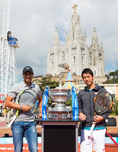 Kei Nishikori (R) and Rafael Nadal (L) attend a promotional event ahead of the Barcelona Open Banc Sabadell at the Tibidabo amusement park on April 18, 2016 in Barcelona, Spain. (April 17, 2016 - Source: Alex Caparros/Getty Images Europe)