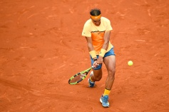 BARCELONA, SPAIN - APRIL 22: Rafael Nadal of Spain plays a backhand against Fabio Fognini of Italy during day five of the Barcelona Open Banc Sabadell at the Real Club de Tenis Barcelona on April 22, 2016 in Barcelona, Spain. Nadal won 6-2, 7-5. (Photo by David Ramos/Getty Images)