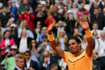 Spain's Rafael Nadal celebrates after winning the Monte-Carlo ATP Masters Series Tournament final match, on April 17, 2016 in Monaco. Nadal defeated Monfils 7-5, 5-7, 6-0 to win a record ninth title at the Monte Carlo Masters.AFP PHOTO / JEAN CHRISTOPHE MAGNENET / AFP / JEAN CHRISTOPHE MAGNENET (April 17, 2016 - Source: AFP)