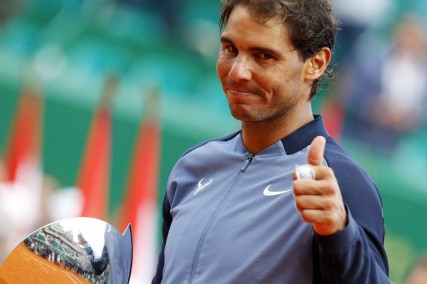 Spain's Rafael Nadal celebrates with his trophy during the awarding ceremony following the final tennis match against France's Gael Monfils at the Monte-Carlo ATP Masters Series Tournament in Monaco on April 17, 2016. Nadal defeated Monfils 7-5, 5-7, 6-0 to win a record ninth title at the Monte Carlo Masters.. AFP PHOTO / JEAN CHRISTOPHE MAGNENET / AFP / JEAN CHRISTOPHE MAGNENET (April 17, 2016 - Source: AFP)