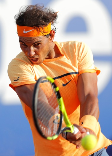 Spain's Rafael Nadal returns a ball to Japan's Kei Nishikori during the Barcelona Open tennis tournament final in Barcelona, Spain, Sunday, April 24, 2016. (AP Photo/Manu Fernandez)