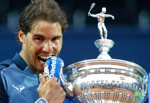 Spain's Rafael Nadal poses for a photo with the trophy after winning the Barcelona Open tennis tournament in Barcelona, Spain, Sunday, April 24, 2016. Spain's Rafael Nadal defeated Japan's Kei Nishikori 6-4 and 7-5, in the final. (AP Photo/Manu Fernandez)