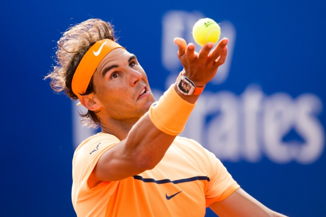 BARCELONA, SPAIN - APRIL 20: Rafael Nadal serves against Marcel Granollers during day three of the Barcelona Open Banc Sabadell at the Real Club de Tenis Barcelona on April 20, 2016 in Barcelona, Spain. (Photo by Alex Caparros/Getty Images)