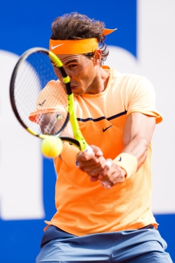 BARCELONA, SPAIN - APRIL 20: Rafael Nadal plays a backhand against Marcel Granollers during day three of the Barcelona Open Banc Sabadell at the Real Club de Tenis Barcelona on April 20, 2016 in Barcelona, Spain. (Photo by Alex Caparros/Getty Images)