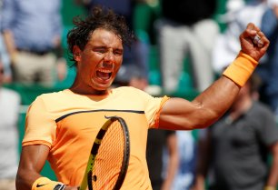 Tennis - Monte Carlo Masters - Monaco, 15/04/2016. Rafael Nadal of Spain reacts after winning his match against Stan Wawrinka of Switzerland. REUTERS/Eric Gaillard