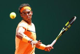 Tennis - Monte Carlo Masters - Monaco, 15/04/2016. Rafael Nadal of Spain plays a shot to Stan Wawrinka of Switzerland. REUTERS/Eric Gaillard