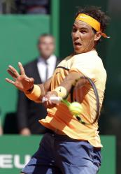 Spain's Rafael Nadal plays a return to Austria's Dominic Thiem during their match of the Monte Carlo Tennis Masters tournament in Monaco, Thursday, April 14, 2016. (AP Photo/Lionel Cironneau)