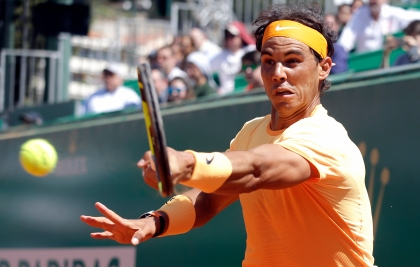 Spain's Rafael Nadal plays a return to Britain's Aljaz Bedene during their match of the Monte Carlo Tennis Masters tournament in Monaco, Wednesday, April 13, 2016. (AP Photo/Lionel Cironneau)