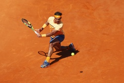 MONTE-CARLO, MONACO - APRIL 14: Rafael Nadal of Spain plays a backhand during the round three match against Dominic Thiem of Austria on day five of Monte Carlo Rolex Masters at Monte-Carlo Sporting Club on April 14, 2016 in Monte-Carlo, Monaco. (Photo by Michael Steele/Getty Images)