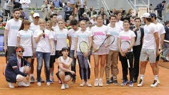MADRID, SPAIN - APRIL 29: Rudy Fernandez (L), Aldo Comas (2L), Rafa Nadal (4L), Lujan Arguelles (5L), Alejandra Silva (6L), Aitor Ocio (7L), Edurne (8L), Nerea Barros (9L), Cayetano Rivera (10L), Martina Hingis (7R), Garbine Muguruza (6R), Jaime Cantizano (5R), Feliciano Lopez (2R) attends Charity Day Tournament during Mutua Madrid Open at La Caja Magica on April 29, 2016 in Madrid, Spain. (Photo by Europa Press/Europa Press via Getty Images)