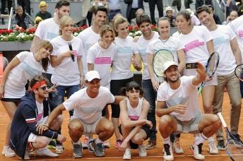 MADRID, SPAIN - APRIL 29: Rudy Fernandez (3L), Aldo Comas (2L), Rafa Nadal (4L), Lujan Arguelles (5L), Alejandra Silva (6L), Aitor Ocio (7L), Edurne (8L), Nerea Barros (9L), Cayetano Rivera (10L), Martina Hingis (7R), Garbine Muguruza (6R), Jaime Cantizano (5R), Feliciano Lopez (2R) attends Charity Day Tournament during Mutua Madrid Open at La Caja Magica on April 29, 2016 in Madrid, Spain. (Photo by Europa Press/Europa Press via Getty Images)