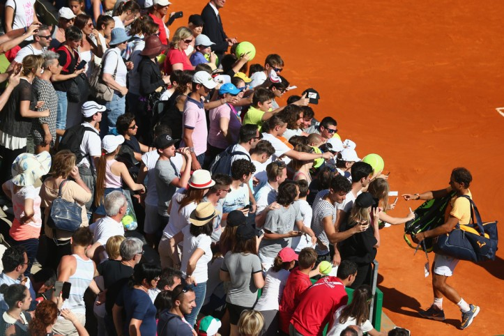 Rafael Nadal of Spain signs autographs after the doubles victory with Fernando Verdasco of Spain against Philipp Kohlschreiber of Germany and Viktor Troicki of Serbia during day two of the Monte Carlo Rolex Masters at Monte-Carlo Sporting Club on April 11, 2016 in Monte-Carlo, Monaco. (April 10, 2016 - Source: Michael Steele/Getty Images Europe)
