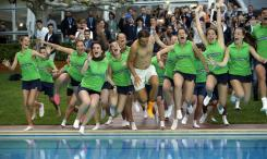 EDS NOTE : SPANISH LAW REQUIRES THAT THE FACES OF MINORS ARE MASKED IN PUBLICATIONS WITHIN SPAIN. Spain's Rafael Nadal, center, jumps into a swimming pool surrounded by tournament's volunteers as they celebrate Nadal's victory at the Barcelona Open tennis tournament in Barcelona, Spain, Sunday, April 24, 2016. Spain's Rafael Nadal defeated Japan's Kei Nishikori 6-4 and 7-5, in the final. (AP Photo/Manu Fernandez)