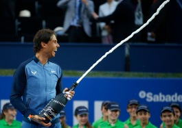 Spain's Rafael Nadal sprays sparkling wine as he celebrates after winning the Barcelona Open tennis tournament in Barcelona, Spain, Sunday, April 24, 2016. Spain's Rafael Nadal defeated Japan's Kei Nishikori 6-4 and 7-5, in the final. (AP Photo/Manu Fernandez)