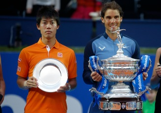 Spain's Rafael Nadal poses for a photo with the trophy, next to Japan's Kei Nishikori, after winning the Barcelona Open tennis tournament in Barcelona, Spain, Sunday, April 24, 2016. Spain's Rafael Nadal defeated Japan's Kei Nishikori 6-4 and 7-5, in the final. (AP Photo/Manu Fernandez)