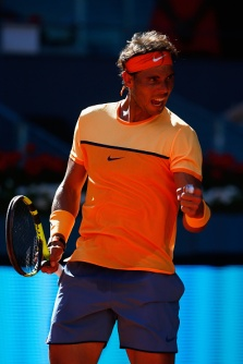 MADRID, SPAIN - MAY 03: Rafael Nadal of Spain celebrates as he defeats Andrey Kuznetsov of Russia during day four of the Mutua Madrid Open tennis tournament at the Caja Magica on May 03, 2016 in Madrid, Spain. (Photo by Julian Finney/Getty Images)