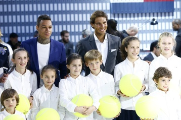 PARIS, FRANCE - MAY 18: (L-R) Gregory van der Wiel and Rafael Nadal pose with children during the Tommy X Nadal party tennis soccer match hosted by Tommy Hilfiger on May 18, 2016 in Paris, France. (Photo by Rindoff Petroff/Hekimian/Getty Images for Tommy Hilfiger)