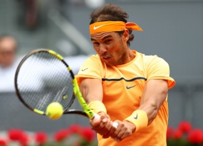 MADRID, SPAIN - MAY 06: Rafael Nadal of Spain hits a backhand during the Men's Singles Quarter Final match against Joao Sousa of Portugal during day seven of the Mutua Madrid Open at La Caja Magica on May 6, 2016 in Madrid, Spain. (Photo by Julian Finney/Getty Images)
