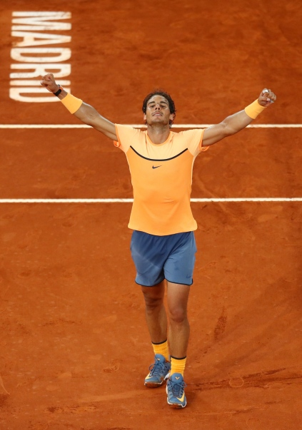 MADRID, SPAIN - MAY 06: Rafael Nadal of Spain celebrates his victory during the Men's Singles Quarter Final match against Joao Sousa of Portugal during day seven of the Mutua Madrid Open at La Caja Magica on May 6, 2016 in Madrid, Spain. (Photo by Julian Finney/Getty Images)