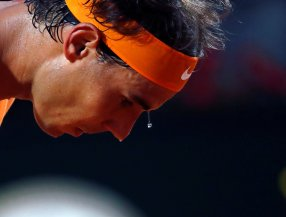 Tennis - Italy Open - Rafael Nadal of Spain v Philipp Kohlschreiber of Germany - Rome, Italy - 11/5/16 Nadal serves. REUTERS/Stefano Rellandini