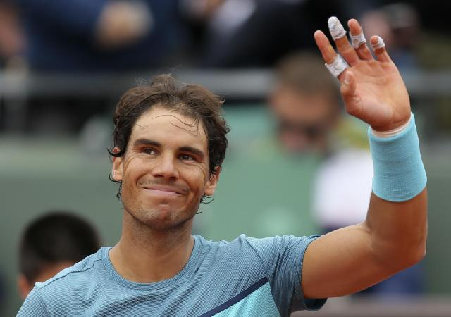 Spain's Rafael Nadal waves after defeating Australia's Sam Groth of the French Open tennis tournament at the Roland Garros stadium, Tuesday, May 24, 2016 in Paris. Nadal won 6-1, 6-1, 6-21. (AP Photo/David Vincent)