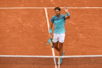 PARIS, FRANCE - MAY 24: Rafael Nadal of Spain celbrates following his victory during the Men's Singles first round match against Sam Groth of Australia on day three of the 2016 French Open at Roland Garros on May 24, 2016 in Paris, France. (Photo by Dennis Grombkowski/Getty Images)