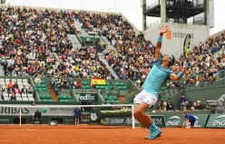 PARIS, FRANCE - MAY 24: Rafael Nadal of Spain serves during the Men's Singles first round match against Sam Groth of Australia on day three of the 2016 French Open at Roland Garros on May 24, 2016 in Paris, France. (Photo by Dennis Grombkowski/Getty Images)