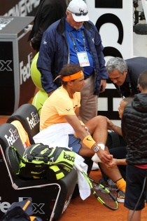 ITALY, ROME - MAY 13: Rafael Nadal of Spain receives medical timeout against Novak Djokovic of Serbia during quarterfinals match ATP Tennis Open tournament at the Foro Italico on May 13, 2016 in Roma, Italy. (Photo by Andrea Spinelli/Corbis via Getty Images)