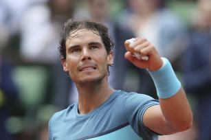 Spain's Rafael Nadal celebrates after defeating Argentina's Facundo Bagnis during their second round match of the French Open tennis tournament at the Roland Garros stadium, Thursday, May 26, 2016 in Paris. Nadal won 6-3, 6-0, 6-3. (AP Photo/David Vincent)