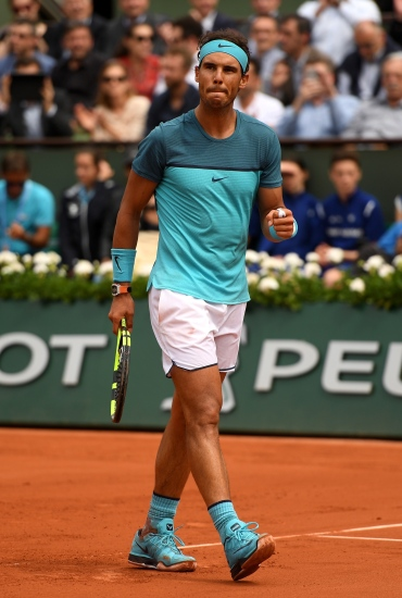 PARIS, FRANCE - MAY 26: Rafael Nadal of Spain celebrates victory during the Men's Singles second round match against Facundo Bagnis of Argentina on day five of the 2016 French Open at Roland Garros on May 26, 2016 in Paris, France. (Photo by Dennis Grombkowski/Getty Images)