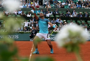 Spain's Rafael Nadal serves the ball to Argentina's Facundo Bagnis during their second round match of the French Open tennis tournament at the Roland Garros stadium, Thursday, May 26, 2016 in Paris. Nadal won 6-3, 6-0, 6-3. (AP Photo/David Vincent)