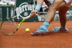 Spain's Rafael Nadal runs and slides to return a shot in his second round match of the French Open tennis tournament against Argentina's Facundo Bagnis at the Roland Garros stadium in Paris, France, Thursday, May 26, 2016. (AP Photo/Alastair Grant)