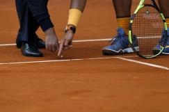 Rafael Nadal, right, from Spain, argues with umpire Carlos Bernardes, from Brazil, about a ball played during the semifinal match against Andy Murray, from Britain, at the Madrid Open tennis tournament in Madrid, Spain, Saturday, May 7, 2016. Murray won 7-5, 6-4 and will play the final on Sunday 8. (AP Photo/Francisco Seco)