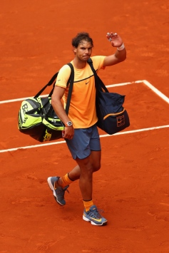 MADRID, SPAIN - MAY 07: Rafael Nadal of Spain waves to the crowd after his loss to Andy Murray of Great Britain in the semi finals during day eight of the Mutua Madrid Open tennis tournament at the Caja Magica on May 07, 2016 in Madrid, Spain. (Photo by Julian Finney/Getty Images)