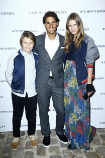 PARIS, FRANCE - MAY 18: Malgosia Bela (R) and her son Jozef Bela pose with Rafael Nadal (L) during the Tommy X Nadal party hosted by Tommy Hilfigeron May 18, 2016 in Paris, France. (Photo by Rindoff Petroff/Hekimian/Getty Images for Tommy Hilfiger)